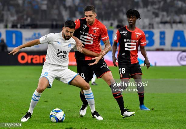 Marseille's French midfielder Morgan Sanson fights for the ball with Rennes' French midfielder Jonas Martin during the French L1 football match...