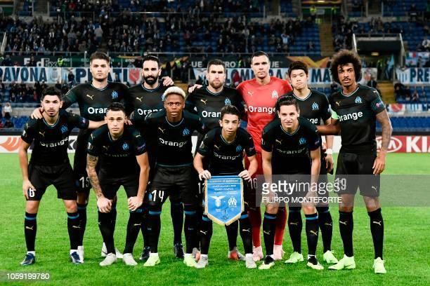 Marseille's French midfielder Morgan Sanson Marseille's Argentine midfielder Lucas Ocampos Marseille's Cameroon forward Clinton Njie Marseille's...