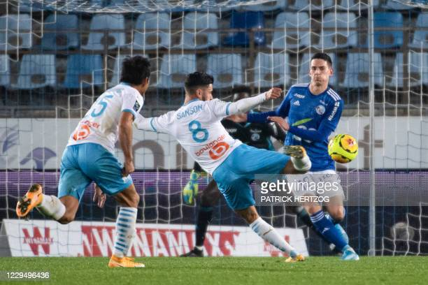 Marseille's French midfielder Morgan Sanson shoots and scores a goal during the French L1 football match between Strasbourg and Marseille on November...