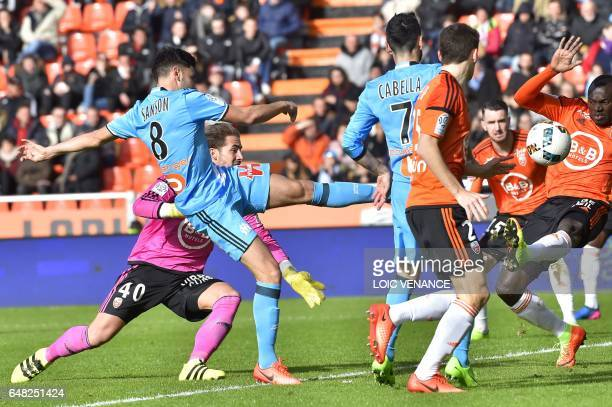 Marseille's French midfielder Morgan Sanson shoots on goal before scoring a goal during the French L1 football match FC Lorient vs Olympique de...