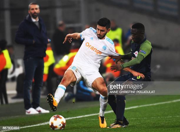 Marseille's French midfielder Morgan Sanson vies with Salzburg's Malian midfielder Diadie Samassekou during the UEFA Europa League Group I football...