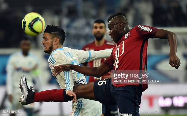 Marseille's French midfielder Remy Cabella vies with Lille's midfielder Ibrahim Amadou during the French L1 football match between Marseille and...