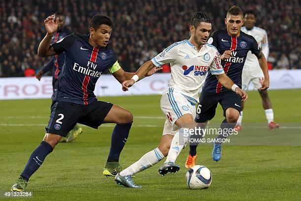 Marseille's French midfielder Remy Cabella vies with Paris SaintGermain's Brazilian defender Thiago Silva during the French L1 football match Paris...