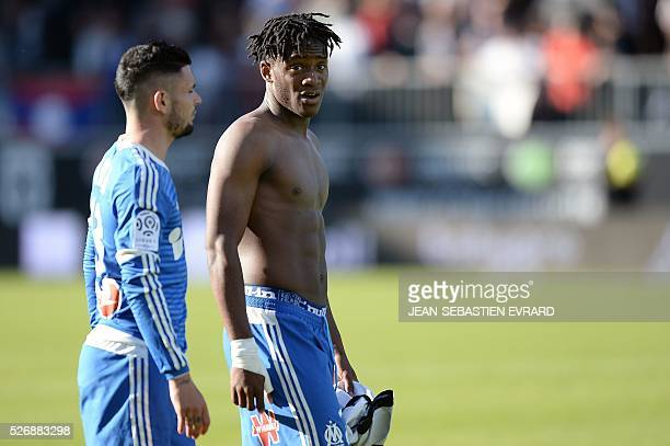 Marseille's French midfielder Romain Alessandrini and Marseille's Belgian forward Michy Batshuayi react at the end of the French L1 football match...
