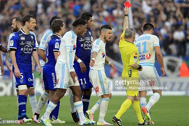 Marseille's French midfielder Romain Alessandrini takes a red card after a fault during the L1 football match Bastia against Marseille on April 3 at...