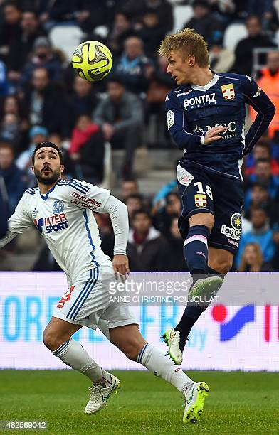 Marseille's French midfielder Romain Alessandrini vies with Evian's Danish defender Daniel Wass during the French L1 football match between Marseille...