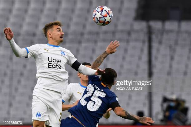 Marseille's French midfielder Valentin Rongier vies for the ball with Porto's Brazilian midfielder Otavio during the UEFA Champions League Group C...