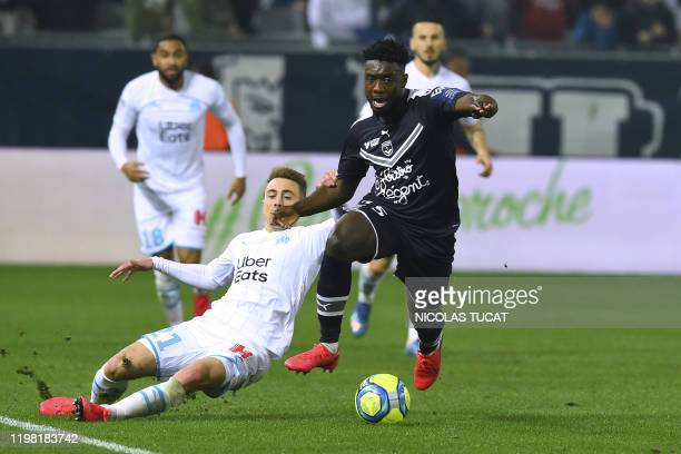 Marseille's French midfielder Valentin Rongier vies with Bordeaux's French defender Enock Kwateng during the French L1 football match between...