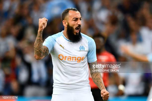 Marseille's Greek forward Konstantinos Mitroglou celebrates after the second goal during the French L1 football match between Marseille and Rennes at...