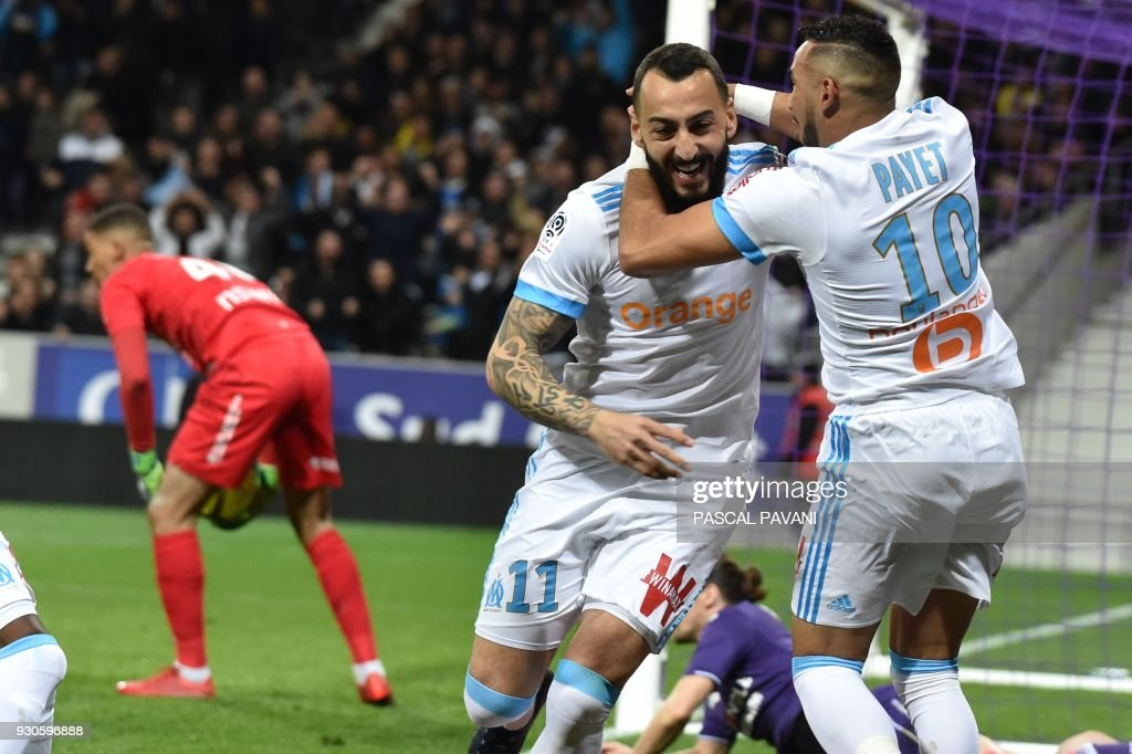 Marseille's Greek forward Konstantinos Mitroglou (L) celebrates with Marseille's French midfielder Dimitri Payet (R) after scoring a goal during the French L1 football match between Toulouse (TFC) and Marseille (OM) March 11, 2018, at the Municipal Stadium in Toulouse, southern France. /
