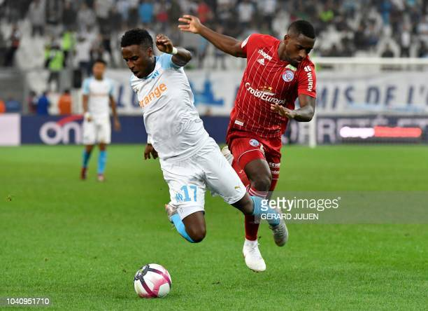 Marseille's Guinean midfielder Bouna Sarr vies with Strasbourg's French defender Lionel Carole during the French L1 football match between Marseille...