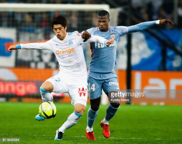 Marseille's Hiroki Sakai and Monaco's Keita Balde vie for the ball in a 22 draw in France's Ligue 1 at Orange Velodrome in Marseille on Jan 28 2018...