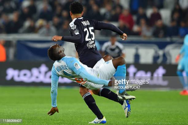 Marseille's Italian forward Mario Balotelli is fouled by Bordeaux's Brazilian defender Pablo during the French Ligue 1 football match between FC...