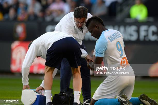 Marseille's Italian forward Mario Balotelli is injured during the French L1 Football match between Rennes and Marseille , on February 24 at the...