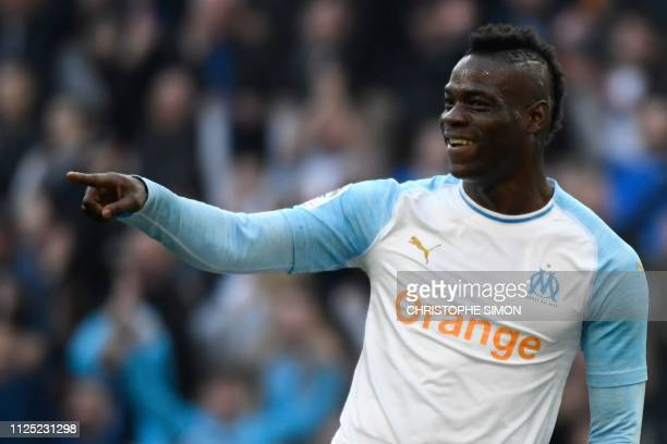 Marseille's Italian forward Mario Balotelli reacts after a goal during the French L1 football match Olympique de Marseille vs Amiens on February 16...