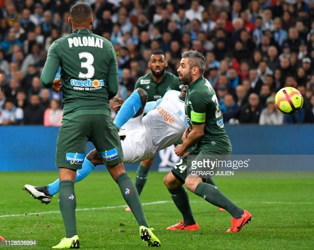 Marseille's Italian forward Mario Balotelli scores the opener during the French L1 football match between Olympique de Marseille and AS SaintEtienne...