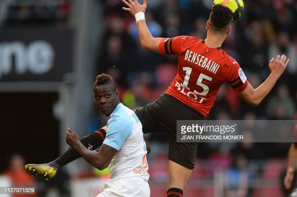 Marseille's Italian forward Mario Balotelli vies with Rennes' Algerian defender Ramy Bensebaini during the French L1 Football match between Rennes...