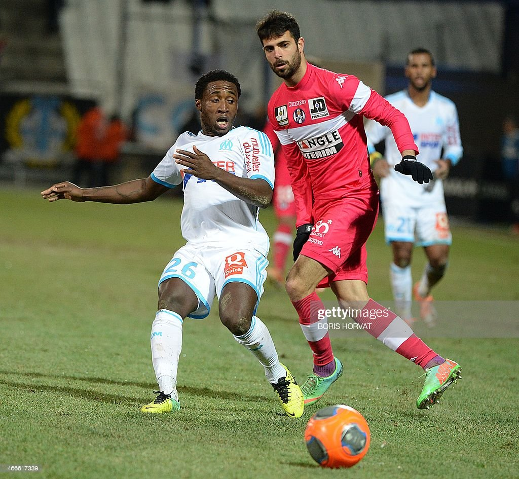 Marseille's Ivory Coast defender Brice Dja Djedje (L) vies with Toulouse's Israeli forward Eden Ben Basat during the French L1 football match Olympique de Marseille vs Toulouse at the Velodrome stadium in Marseille, on February 2, 2014.