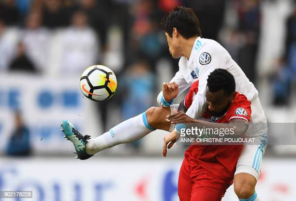 Marseille's Japanese defender Hiroki Sakai vies for the ball with Valenciennes's midfielder Lenny Nangis during the French Cup football match between...