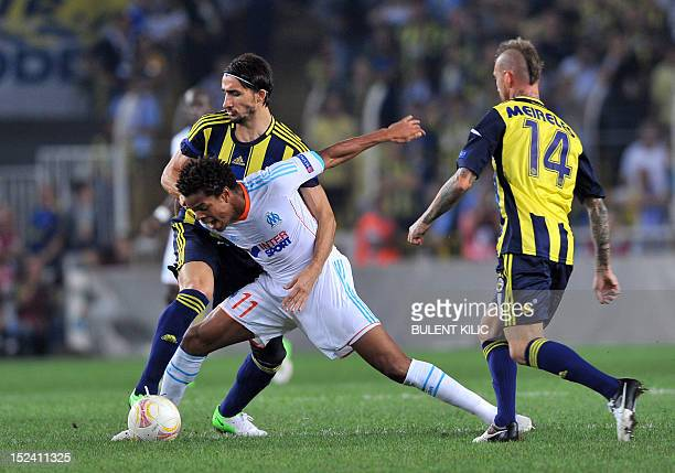 Marseille's Loic Remy vies for the ball with Fenerbahce's Hasan Ali Kaldirim during their UEFA Europa League group football match on September 20...