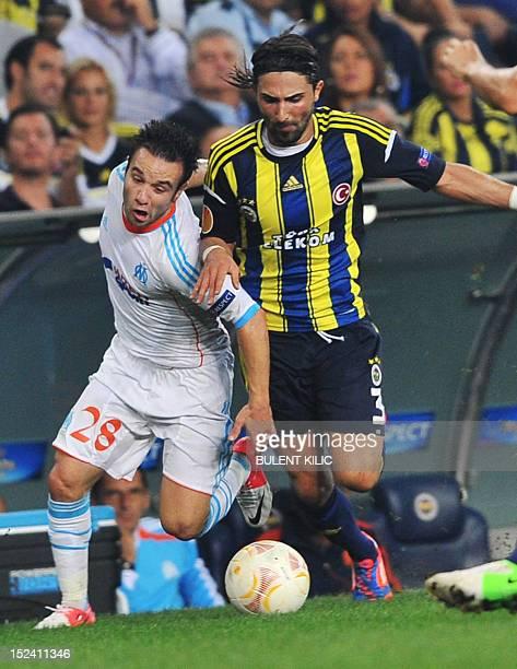 Marseille's Mathieu Valbuena vies for the ball with Fenerbahce's Hasan Ali Kaldirim during their UEFA Europa League group match on September 20 2012...