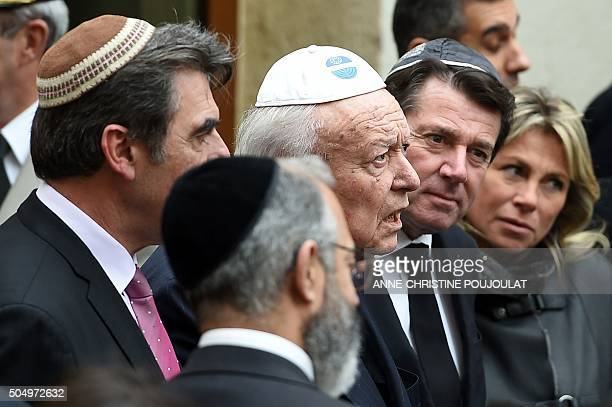 Marseille's Mayor JeanClaude Gaudin and president of the Provence Alpes Cote d'Azur region Christian Estrosi speak with members of the Jew community...