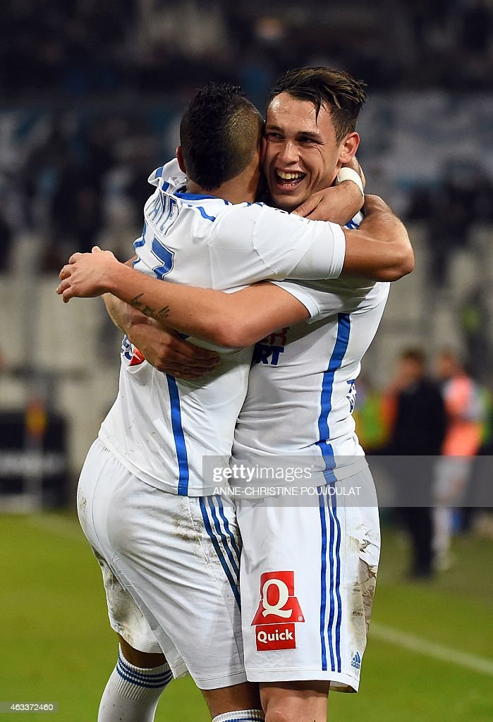 Marseille's midfielder Lucas Ocampos (R) reacts during the French L1 football match Marseille vs Reims on February 13, 2015 at the Velodrome stadium in Marseille, southern France.