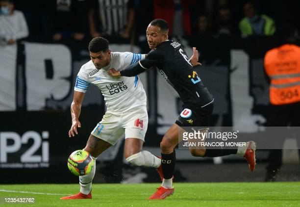 Marseille's Moroccan midfielder Amine Harit fights for the ball with Angers' French defender Enzo Ebosse during the French L1 football match between...