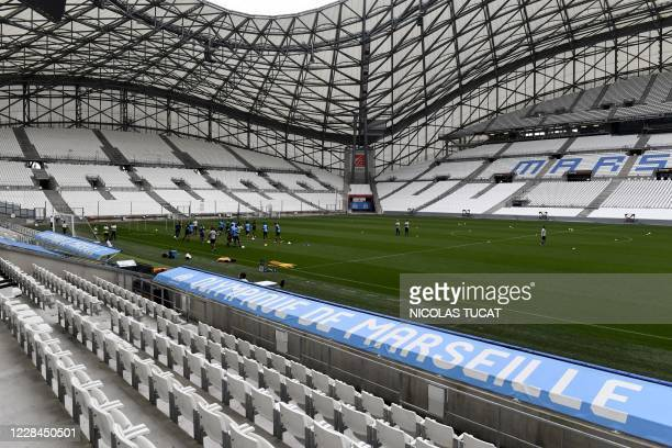 Marseille's players attend a training session at the Stade Velodrome in Marseille on September 11 a few days ahead of their French L1 football match...
