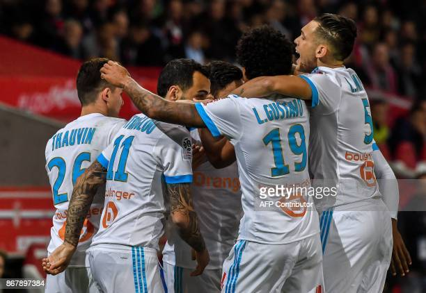Marseille's players celebrate a goal by French midfielder Morgan Sanson during the French L1 football match between Lille OSC and Olympique de...