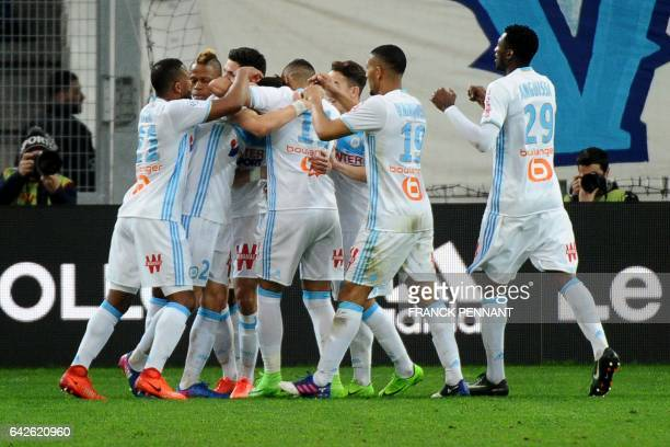 Marseille's players celebrate after a goal during the French L1 football match between Marseille and Rennes on February 18 at the Velodrome stadium...