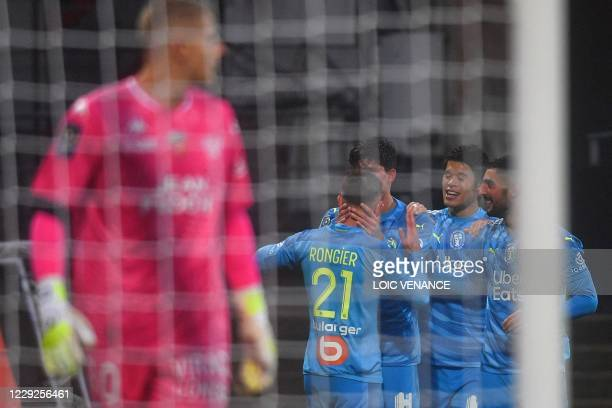 Marseille's players celebrate after scoring a goal during the French L1 football match between Lorient and Marseille at the Moustoir stadium in...