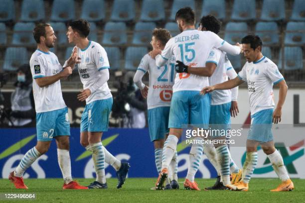 Marseille's players celebrate after scoring a goal during the French L1 football match between Strasbourg and Marseille on November 6, 2020 at the...