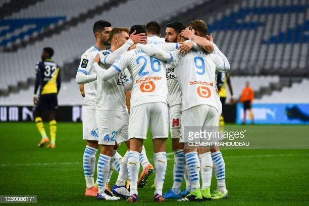 Marseille's players celebrate after scoring during the French L1 football match between Olympique de Marseille and AS Monaco at the Velodrome Stadium...