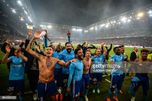TOPSHOT Marseille's players celebrate after the UEFA Europa League semifinal second leg match between FC Salzburg and Olympique de Marseille on May 3...