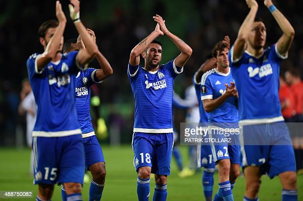 Marseille's players celebrate after the UEFA Europe League Group F football match between FC Groningen and Olympique Marseille at the Euroborg...