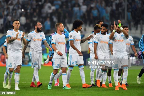 Marseille's players celebrate their victory at the end of the UEFA Europa League firstleg semifinal football match between Olympique de Marseille and...