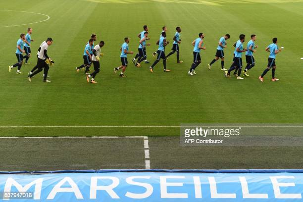Marseille's players take part in a training session at the Velodrome Stadium in Marseille, southeastern France, on August 23, 2017 on the eve of the...