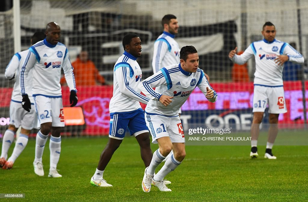 Marseille's players warm up before the French L1 football match Marseille vs Reims on February 13, 2015 at the Velodrome stadium in Marseille, southern France.