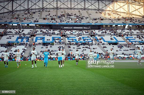 Marseille's players warm up prior to the French L1 football match Marseille and Reims on May 7 2016 at the Velodrome stadium in Marseille southern...