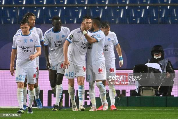 Marseille's Polish forward Arkadiusz Milik celebrates with teammates after scoring his team's first goal during the French L1 football match between...