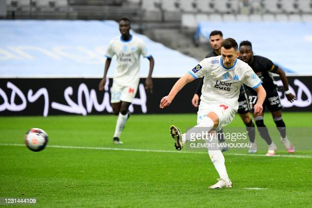 Marseille's Polish forward Arkadiusz Milik takes a penalty kick to score a goal during the French L1 football match between Olympique de Marseille...
