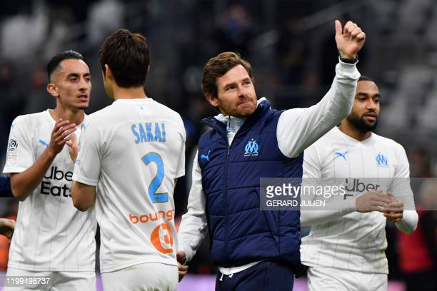 Marseille's Portuguese coach Andre Villas Boas greets supporters after winning the French L1 football match between Olympique de Marseille and...
