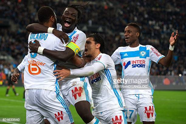 Marseille's Portuguese defender Jorge Pires Da Fonseca Rolando celebrates with teammates after scoring a goal during the French L1 football match...