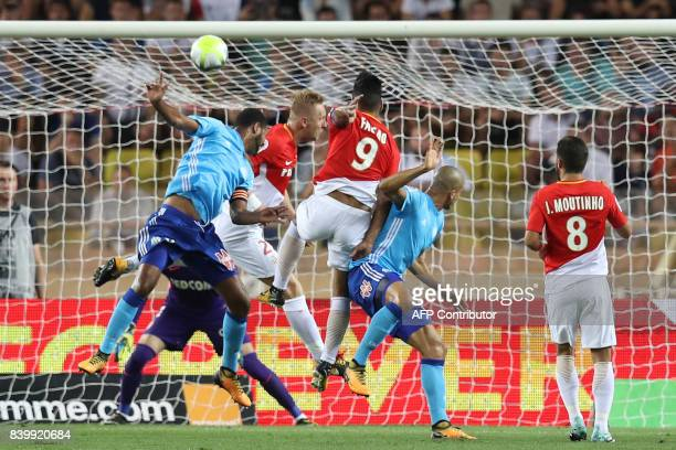 TOPSHOT Marseille's Portuguese defender Rolando Monaco's Polish defender Kamil Glik Monaco's Colombian forward Radamel Falcao and Marseille's...
