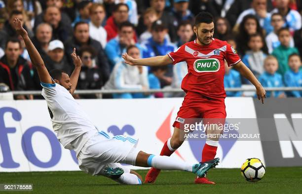 Marseille's Portuguese defender Rolando vies for the ball with Valenciennes's midfielder Tony Mauricio during the French Cup football match between...