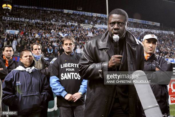 Marseille's president Pape Diouf speaks to his team supporters on December 6 2008 at the Velodrome stadium in Marseille prior to the French L1...