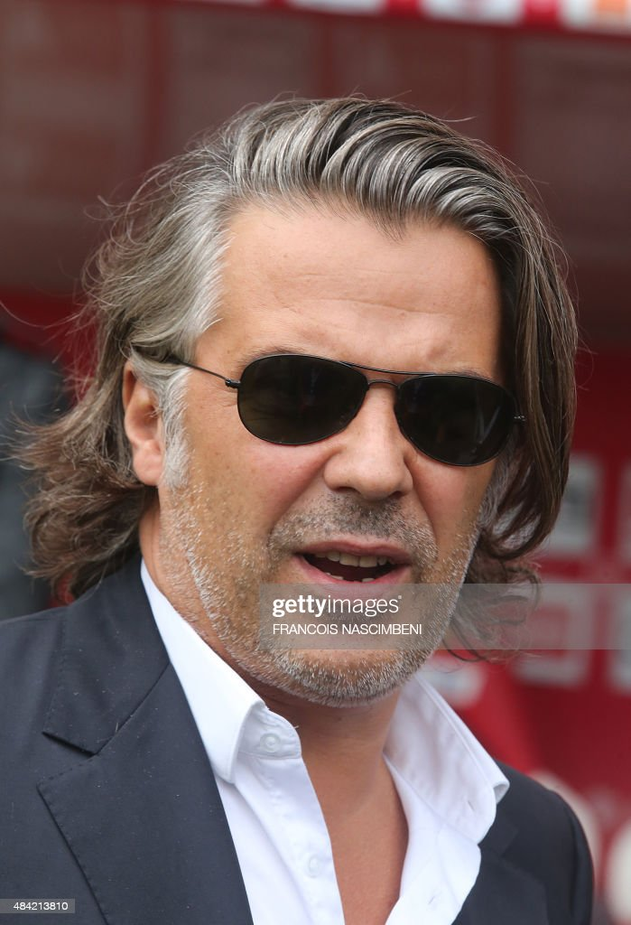 Marseille's President Vincent Labrune looks on prior to the Ligue 1 football match between Reims and Marseille on August16, 2015 at the Auguste Delaune Stadium in Reims..