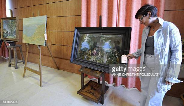 Marseille's regional judiciary police's head of general staff Catherine Lenzi stands on June 05 2008 in Marseille southern France next to a Jan...