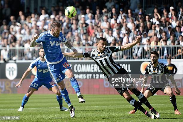 Marseille's Scottish forward Steven Fletcher vies with Angers' Moroccan midfielder Romain Saiss during the French L1 football match between Angers...
